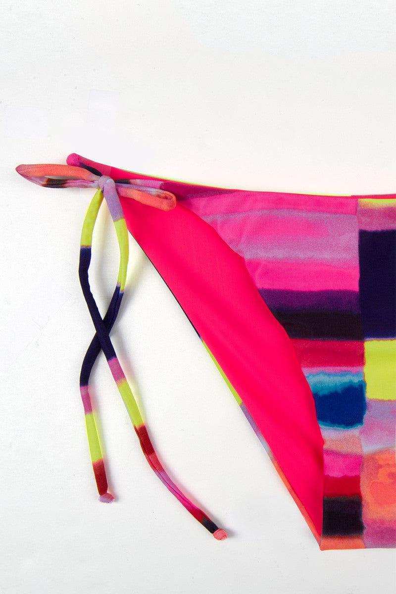 MARA HOFFMAN Tie Side Bikini Bottom - Solstice Rainbow Geometric Print Bikini Bottom | Solstice Rainbow Geometric Print| Mara Hoffman Tie Side Bikini Bottom - Solstice Rainbow Geometric Print Classic tie side bikini bottom in vibrant geometric print. Low-rise cut with high legs Front View