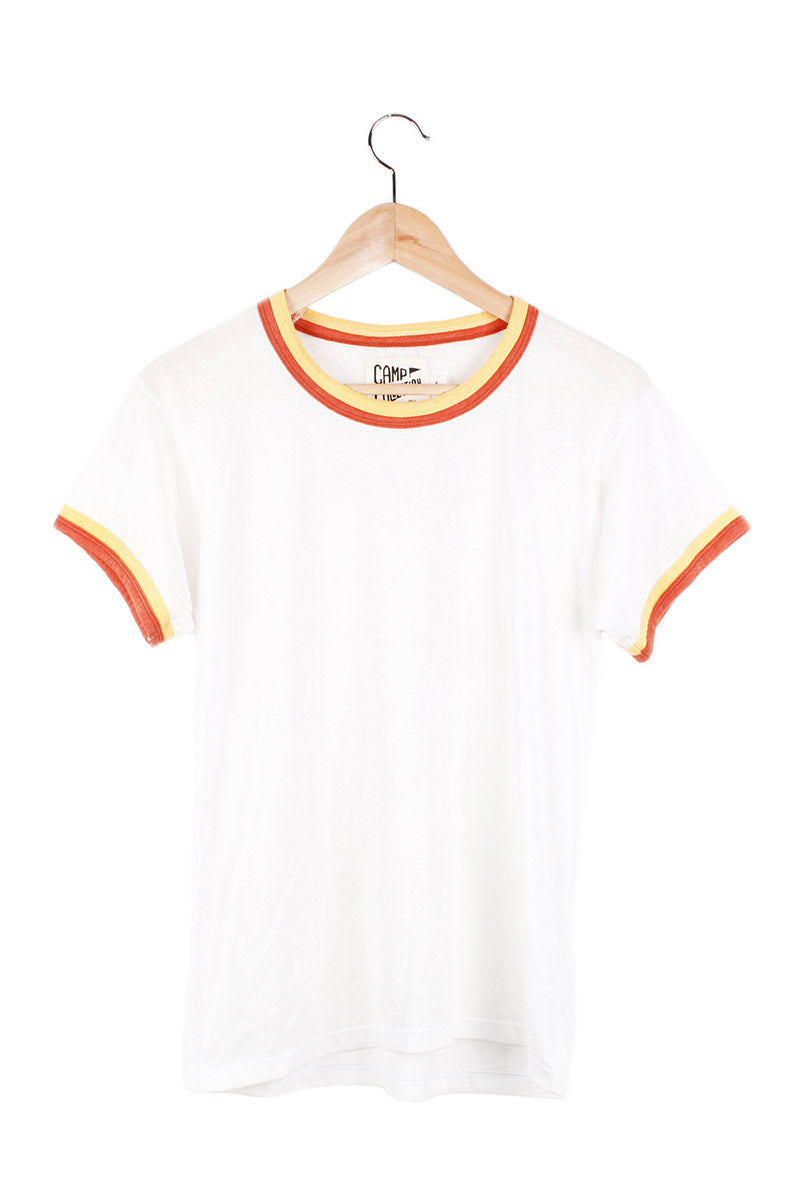 CAMP COLLECTION Double Trouble Ringer Tee - Vintage White W/Sunshine Top | Vintage White W/Sunshine | Camp Collection Double Trouble Ringer Tee - Vintage White W/Sunshine Front View Crew neck tee Short sleeves Two-color binding at neck and sleeves. Slightly sheer vintage white jersey. Locker loop at back neck. – Machine wash cold, tumble dry low – 60% cotton / 40% polyester  – Manufactured in the USA
