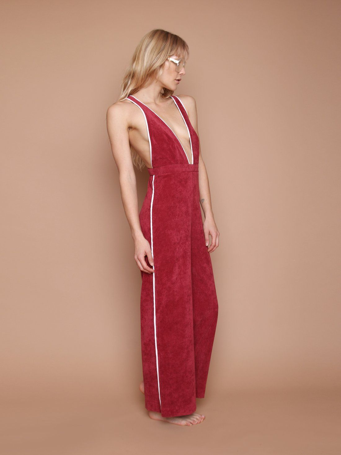 CAMP COLLECTION Jan Jumpsuit - Maroon Corduroy Jumpsuit | Maroon Corduroy| Camp Collection Jan Jumpsuit - Maroon Corduroy Side View Corduroy jumpsuit Ankle-length High waisted Wide leg  Cream piping throughout Adjustable straps   Dropped crotch  Center back invisible zipper  Elastic at back waist for comfy fit Dry clean only 90% polyester / 8% nylon / 2% elastane