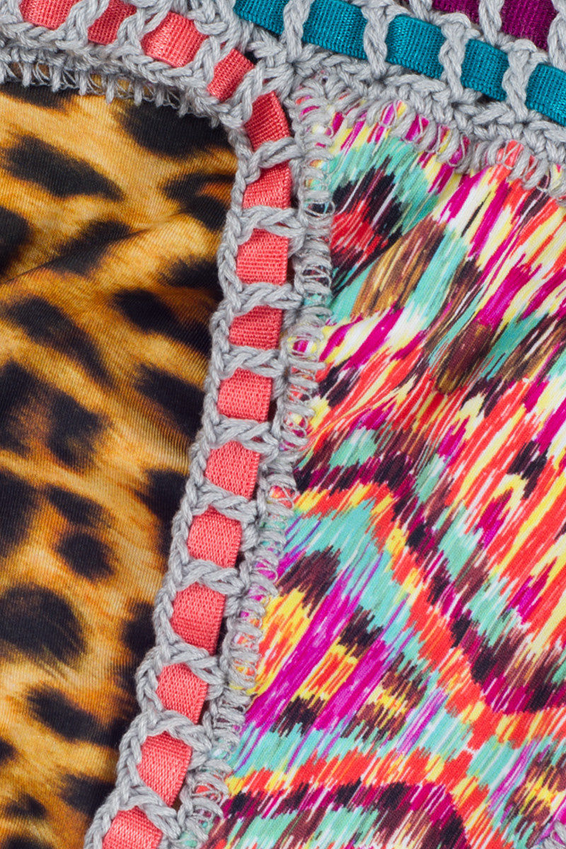 CAPITTANA Eduarda Reversible Bikini Bottom Bikini Bottom | Fusion Print| Capittana Eduarda Reversible Bikini Bottom close up Bold animal print and vibrant abstract feather print reversible bikini bottom with crochet trim.