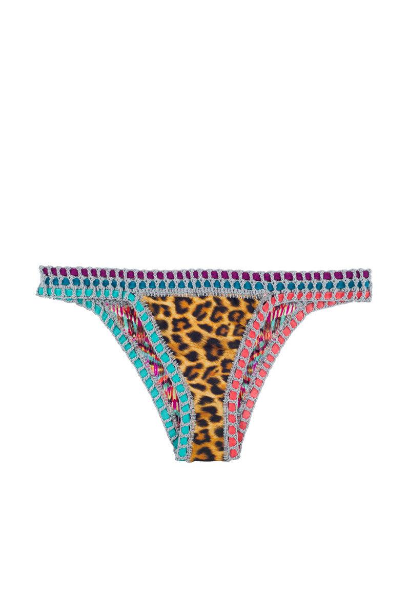CAPITTANA Eduarda Reversible Bikini Bottom Bikini Bottom | Fusion Print| Capittana Eduarda Reversible Bikini Bottom flat lay front view Bold animal print and vibrant abstract feather print reversible bikini bottom with crochet trim.