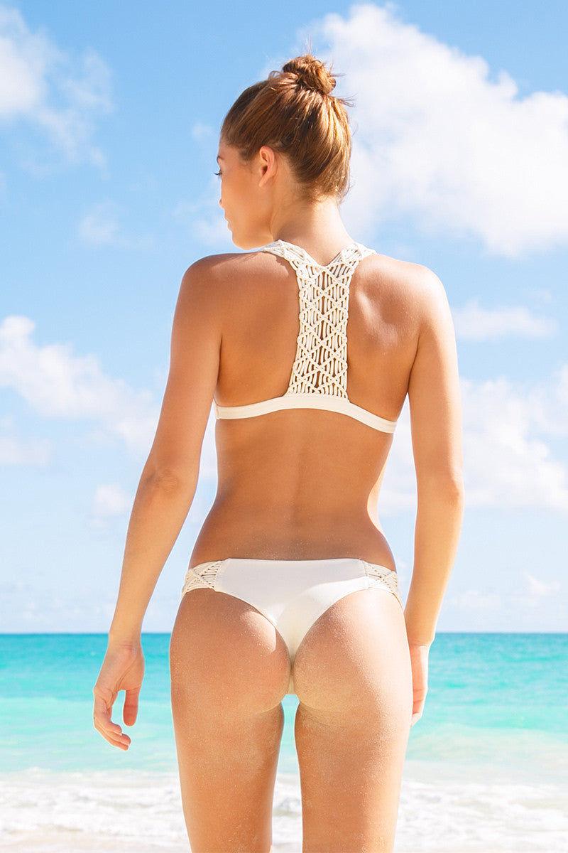 MIKOH Tuamotu Macrame T-Back Bikini Top - Bone White Bikini Top   Bone White  Mikoh Tuamotu Macrame T-Back Bikini Top - Bone White Bralette Macrame detailed straps and back T back Light double lining 80% Nylon, 20% Spandex Back View