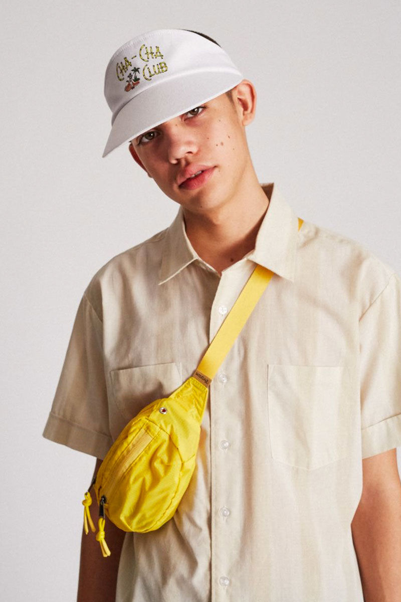 "BRIXTON Cha Cha Graphic Snapback Cotton Visor - White Hat | White| Brixton Cha Cha Visor - White  100% Cotton Classic Sport Visor Design ""Cha-Cha Club"" Printed Detail - Front Plastic Snapback Adjuster Cotton Twill Sweatband Front View"