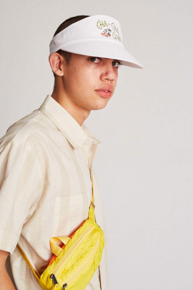 "BRIXTON Cha Cha Graphic Snapback Cotton Visor - White Hat | White| Brixton Cha Cha Visor - White  100% Cotton Classic Sport Visor Design ""Cha-Cha Club"" Printed Detail - Front Plastic Snapback Adjuster Cotton Twill Sweatband Side View"