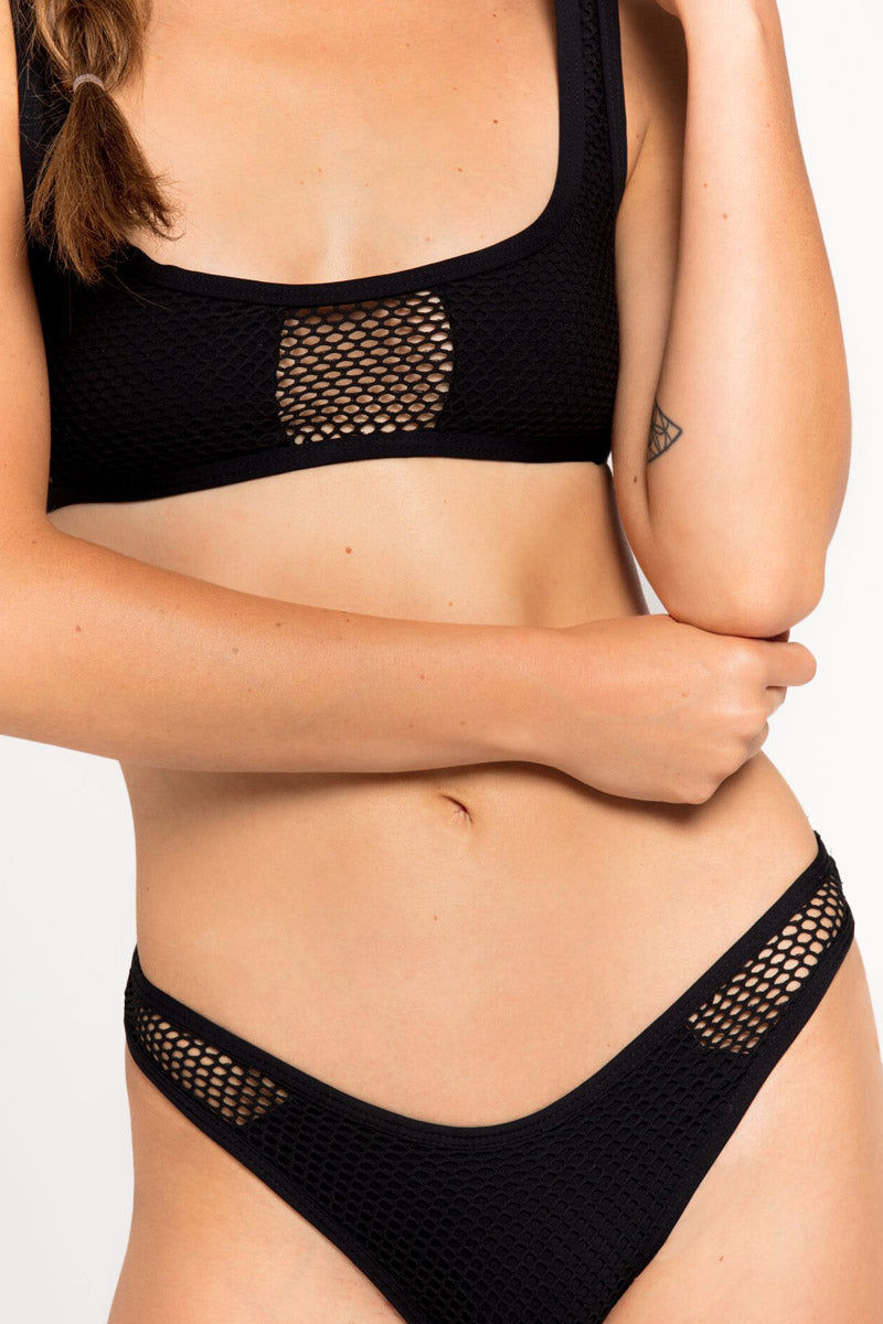 L SPACE Benji Mesh Bralette Bikini Top - Black Bikini Top | Black| L Space Benji Mesh Bralette Bikini Top - Black Scoop neckline Center cut out Cutout mesh designs Fixed shoulder straps Lined cups Pull over Front View