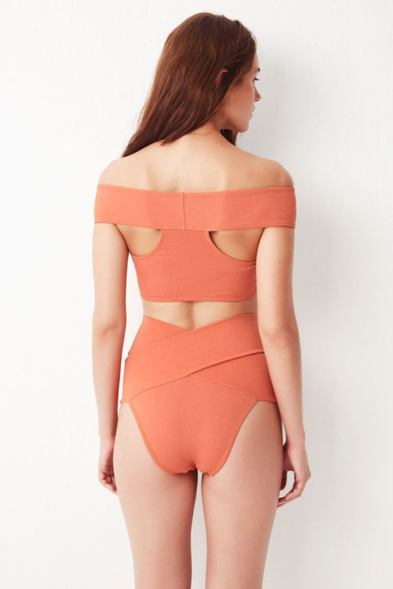 OYE SWIMWEAR Lucette Criss Cross Bikini Top - Coral Bikini Top | Coral| OYE Swimwear Lucette Criss Cross Bikini Top - Coral. Features: Figure-shaping statement bikini top. Criss-cross off-the-shoulder design sculpts curves while supporting larger breasts. Criss-cross lace up side detail.  Suitable for D and DD cup sizes. Deep red color is perfect for every skin tone. Coral-peach color is best with warm skin tones. Pair with adjustable Lucette bikini bottom to form the perfect hourglass figure. Add a sheer high-waisted skirt for beach-to-bar style.