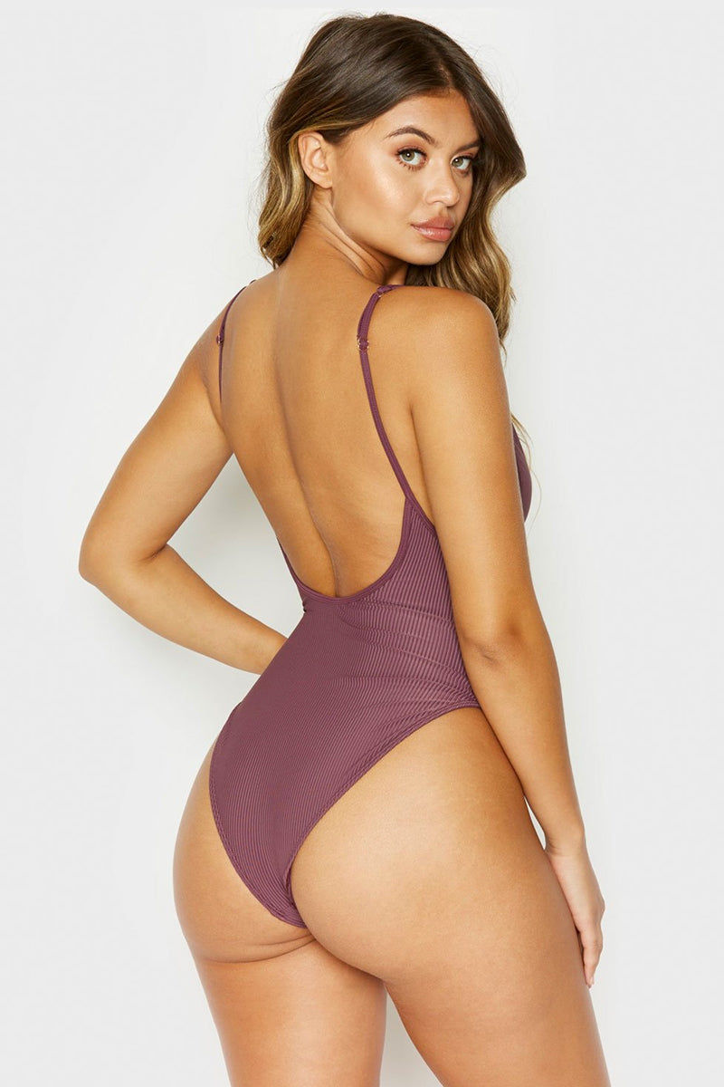 FRANKIES BIKINIS Daphne Ribbed Button Up Front One Piece Swimsuit - Sangria Purple One Piece | Sangria Purple| Frankies Bikinis Daphne Ribbed Button Up Front One Piece Swimsuit - Sangria Purple Scoop neckline Front button detail Adjustable shoulder straps High cut leg Scoop back Cheeky coverage Ribbed fabric Back View