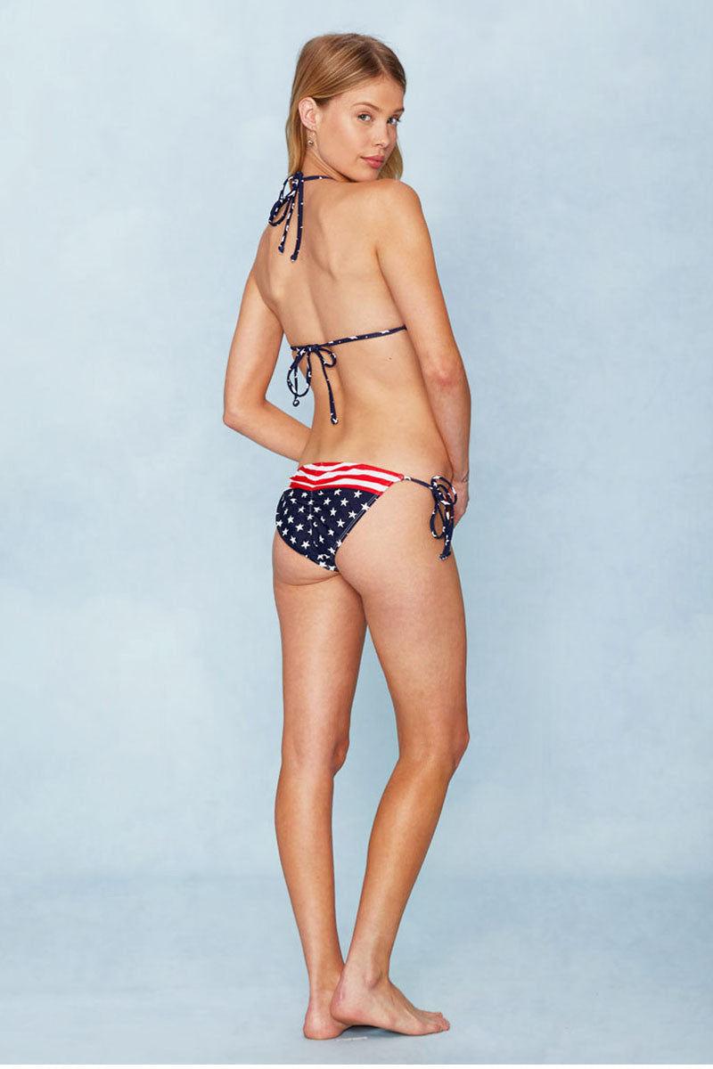 BEACH JOY Americana Adjustable Tie Side Bikini Bottom - Stars and Stripes Print Bikini Bottom | Stars and Stripes Print| Americana Adjustable Tie Side Bikini Bottom - Stars and Stripes Print. Full View. Adjustable tie side. Moderate Coverage.