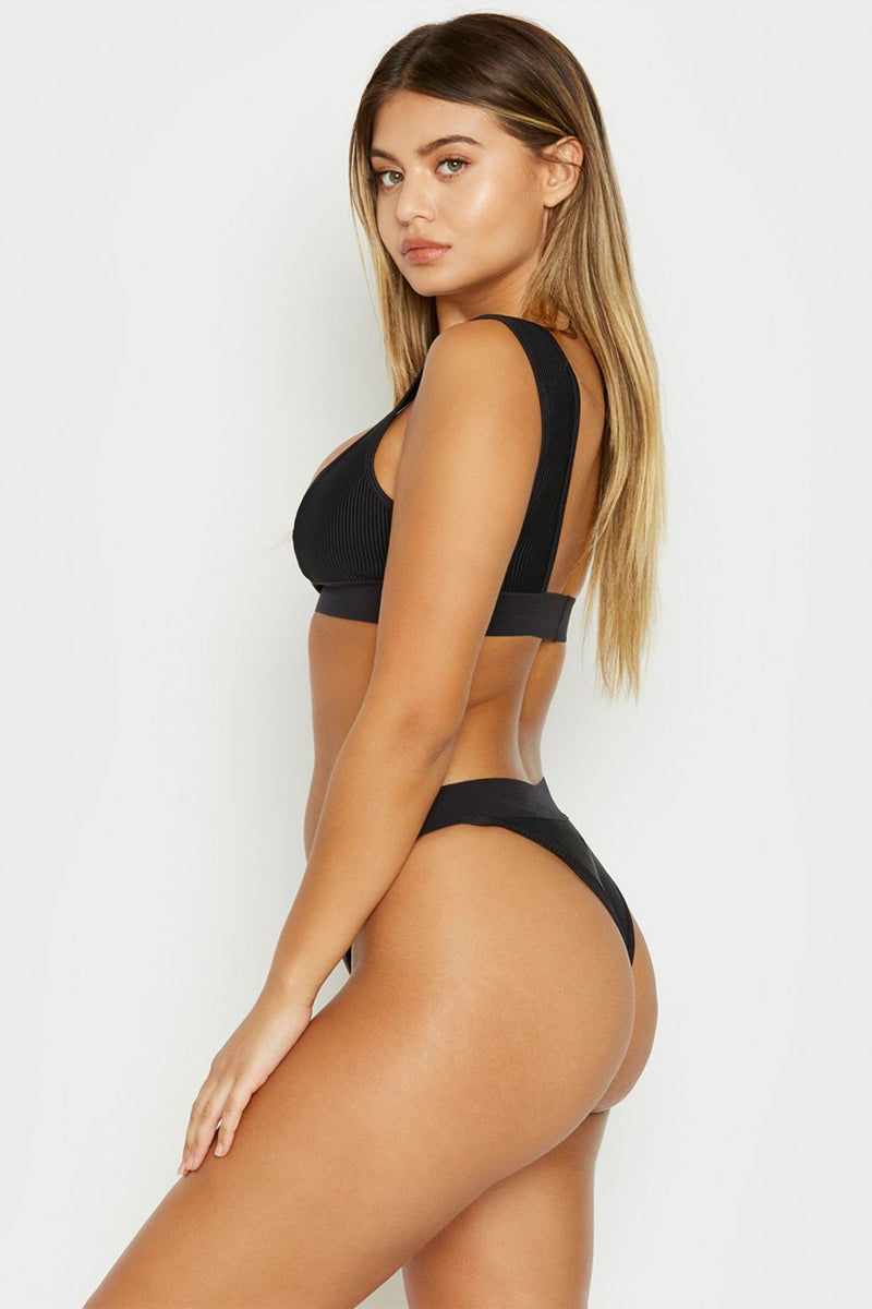FRANKIES BIKINIS Drew Ribbed Elastic Band Bikini Top - Black Bikini Top | Black| Frankies Bikinis Drew Ribbed Elastic Band Bikini Top - Black Sports bra style scoop neck ribbed bikini top in black.Wide elastic underbust band and fixed wide shoulder straps  Side View