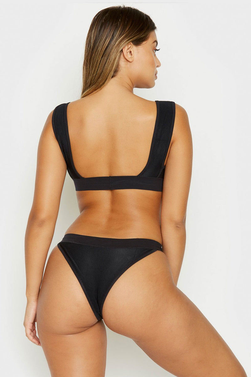 FRANKIES BIKINIS Drew Ribbed Elastic Band Bikini Top - Black Bikini Top | Black| Frankies Bikinis Drew Ribbed Elastic Band Bikini Top - Black Sports bra style scoop neck ribbed bikini top in black.Wide elastic underbust band and fixed wide shoulder straps  Back View