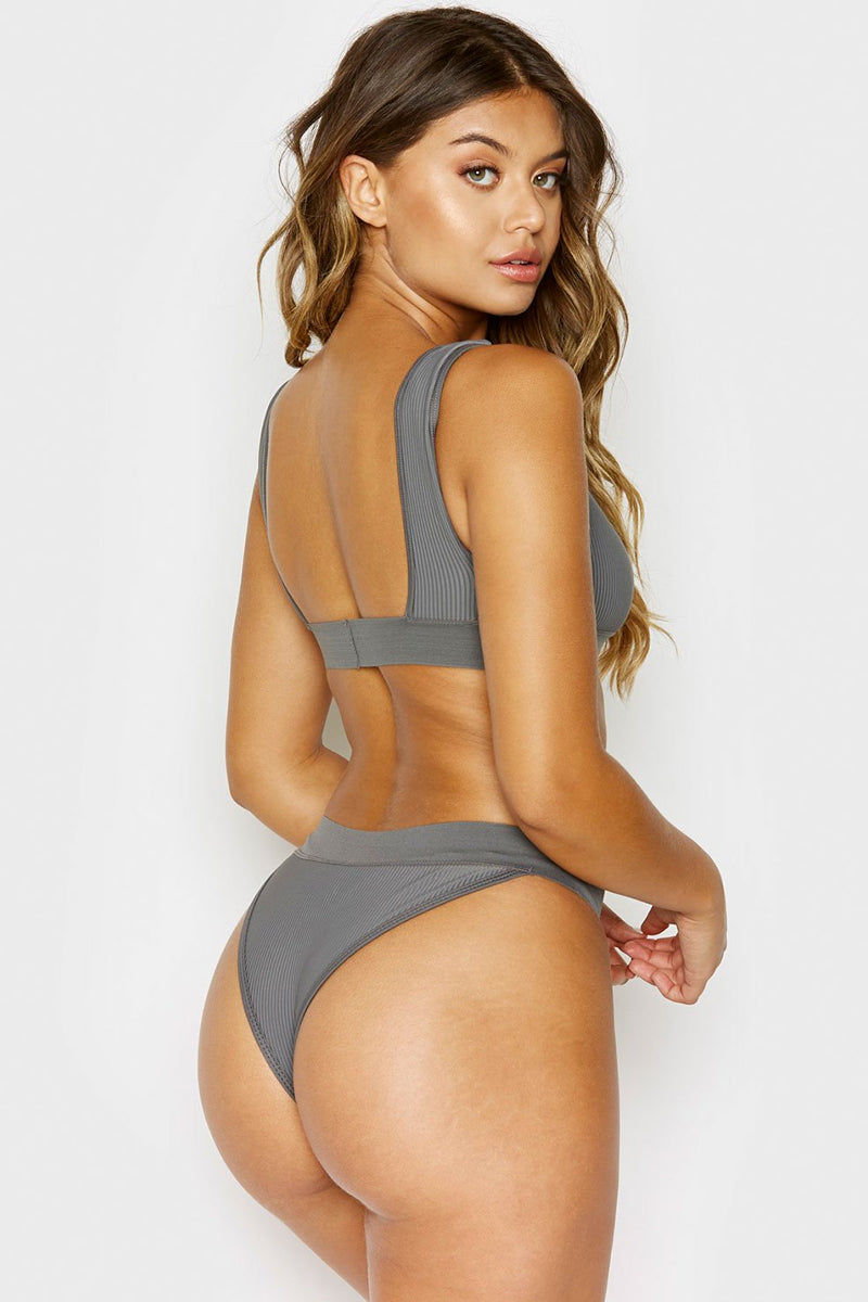 FRANKIES BIKINIS Drew Ribbed Elastic Band Bikini Top - Caviar Grey Bikini Top | Caviar Grey | Frankies Bikinis Drew Ribbed Elastic Band Bikini Top - Caviar Grey Sports bra style scoop neck ribbed bikini top in grey .Wide elastic underbust band and fixed wide shoulder straps  Back View