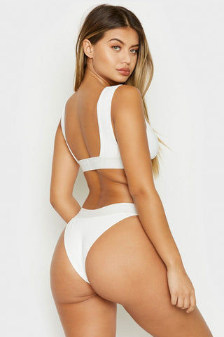 FRANKIES BIKINIS Drew Ribbed Elastic Band Bikini Top - White Bikini Top | White | Frankies Bikinis Drew Ribbed Elastic Band Bikini Top - White Sports bra style scoop neck ribbed wide elastic underbust band and fixed wide shoulder straps  Back View