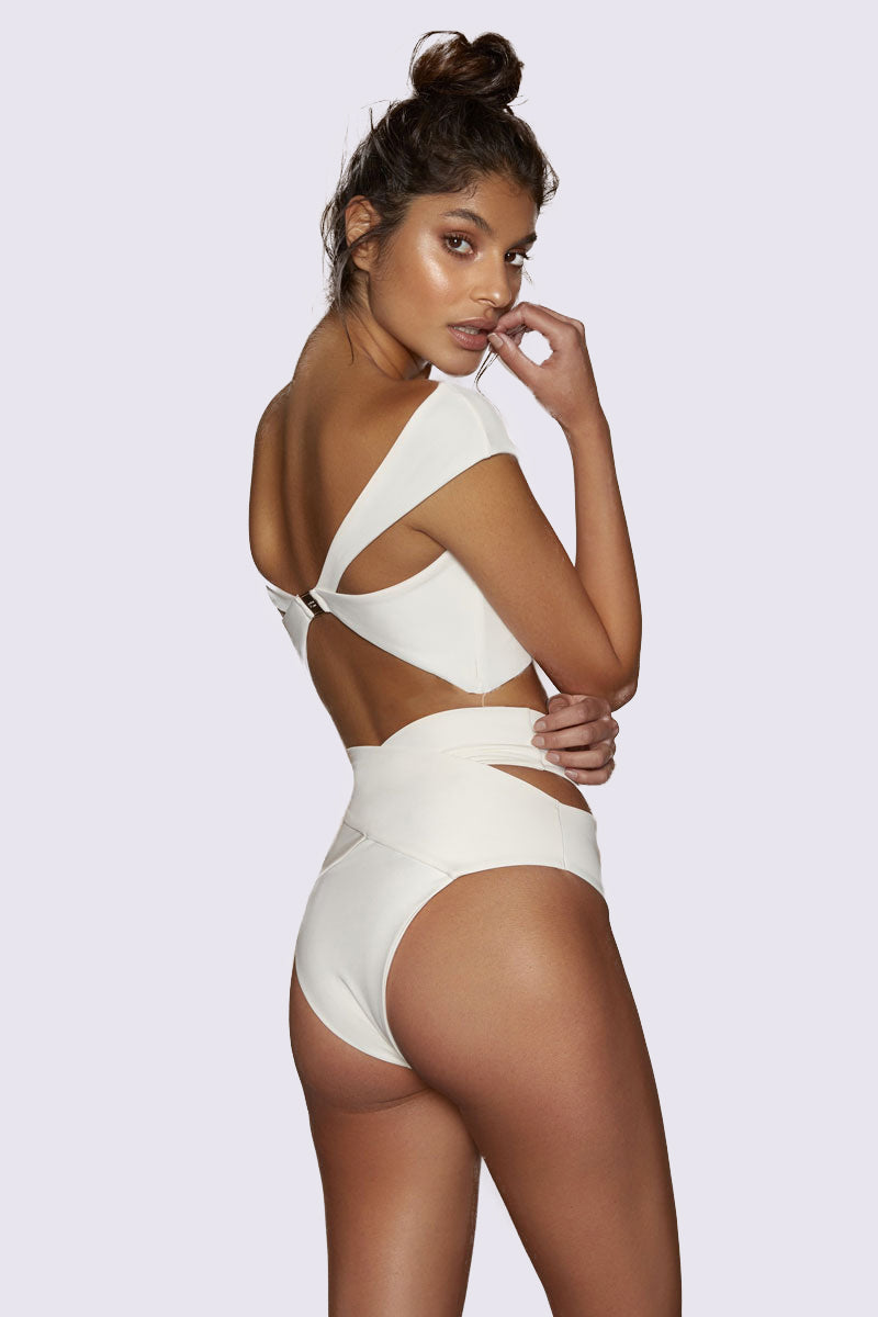 KOPPER & ZINK Duke Crisscross High Waisted Bikini Bottom - Cream Bikini Bottom |  Cream| Kopper & Zink Duke Crisscross High Waisted Bikini Bottom - Cream. Features:  High waisted bikini bottom Supportive ribbed fabric  Crossover and cut out detailing Moderate coverage Fabric: 91% Nylon, 9% Spandex Care: Hand wash. Imported. Back View