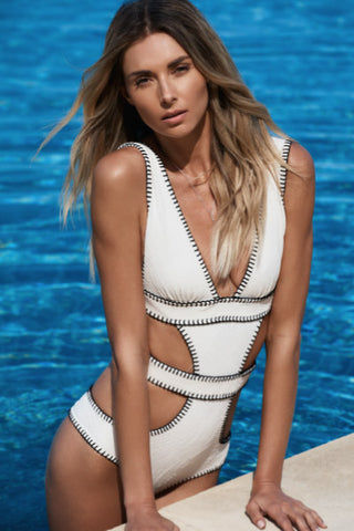ELLEJAY Amores Cut Out One Piece Swimsuit - Ivory Texture One Piece | Ivory Texture| Ellejay Amores One Piece Ivory one piece with black whipstitch borders. Large cut outs on waist and hips. Deep v neckline.
