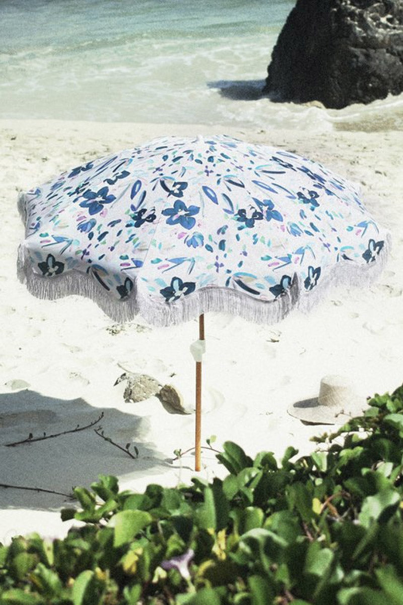 """BUSINESS AND PLEASURE CO Holiday Beach Umbrella - Floral Pool Accessories    Floral  BUSINESS AND PLEASURE CO Holiday Beach Umbrella - Floral. Features:  Convenient 5.5"""" Span. Printed poly/cotton canvas. World forestries certified, reclaimed timber wood Pole with Chestnut finish. Polyester bullion fringe. Canvas Carry Bag in same print design. Natural cardboard gift box. Span: Holiday 5.5""""  Height: Holiday 6""""  Front View"""