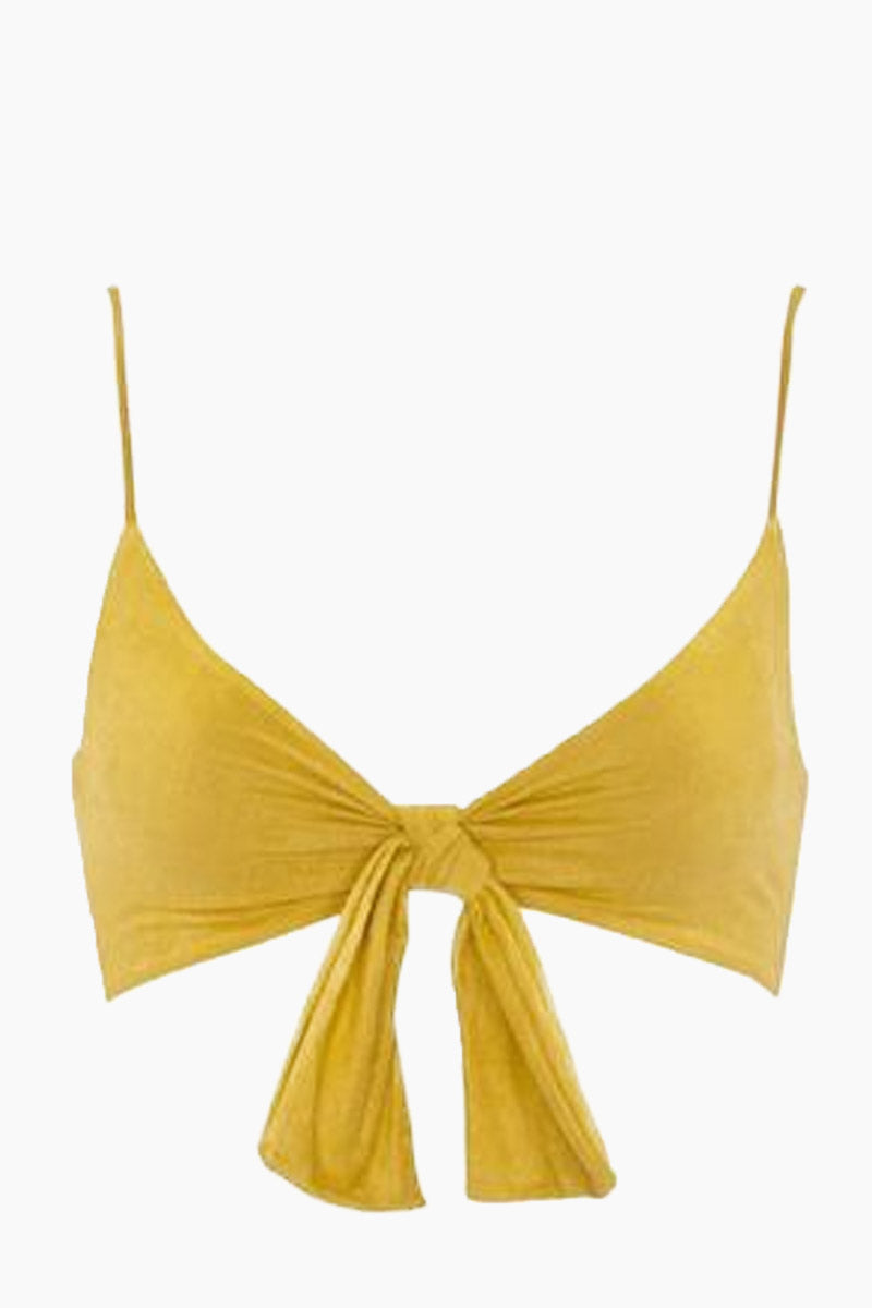 MONICA HANSEN BEACHWEAR Start Me Up Front Knot Bikini Top - Yellow Suede Bikini Top | Yellow Suede| Monica Hansen Beachwear Start Me Up Front Knot Bikini Top - Yellow Suede.V neckline Thick front tie detail Adjustable shoulder straps Back clasp closure Double fabric on the inside instead of lining Italian fabric 85% Nylon 15% Elastane Manufactured in Italy Hand wash cold.  Dry flat Front View