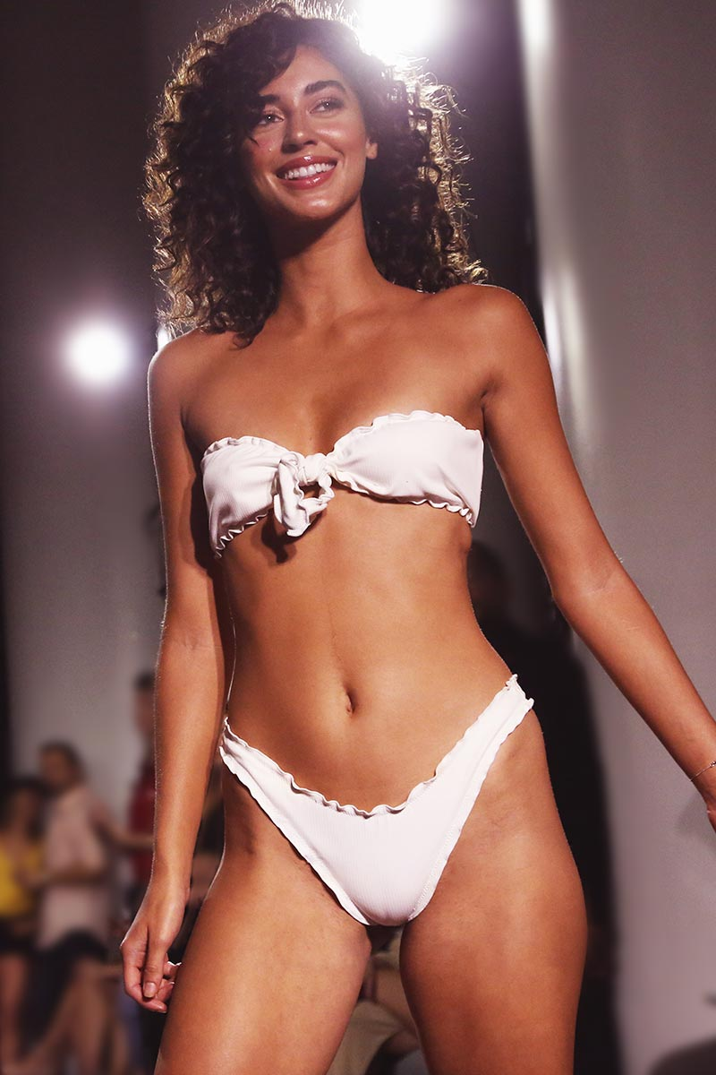 MGS 2019 Sugar Ruffle Bandeau Bikini Top - White Rib Bikini Top | White Rib| MGS 2019 Sugar Ruffle Bandeau Bikini Top - White Rib. Features:  Bandeau bikini top Ruffle edge Adjustable front tie Fabric Content:  Rib fabric Front View