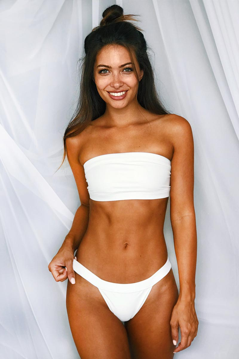 MGS 2019 Bubbles Cheeky Bikini Bottom - White Bikini Bottom | White | MGS 2019 Bubbles Cheeky Bikini Bottom - White. Features:  Banded rib basic bottom Cheeky coverage with Lycra Thick side straps High leg cut Fabric Content: Soft lycra with rib binding Front View