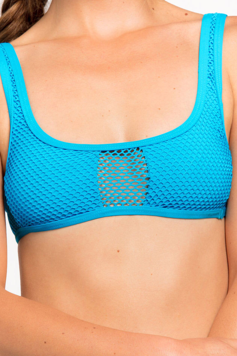 L SPACE Benji Mesh Bralette Bikini Top - Cerulean Bikini Top   Cerulean  L Space Benji Mesh Bralette Bikini Top - Cerulean Scoop neckline Center cut out Cutout mesh designs Fixed shoulder straps Lined cups Pull over Front View
