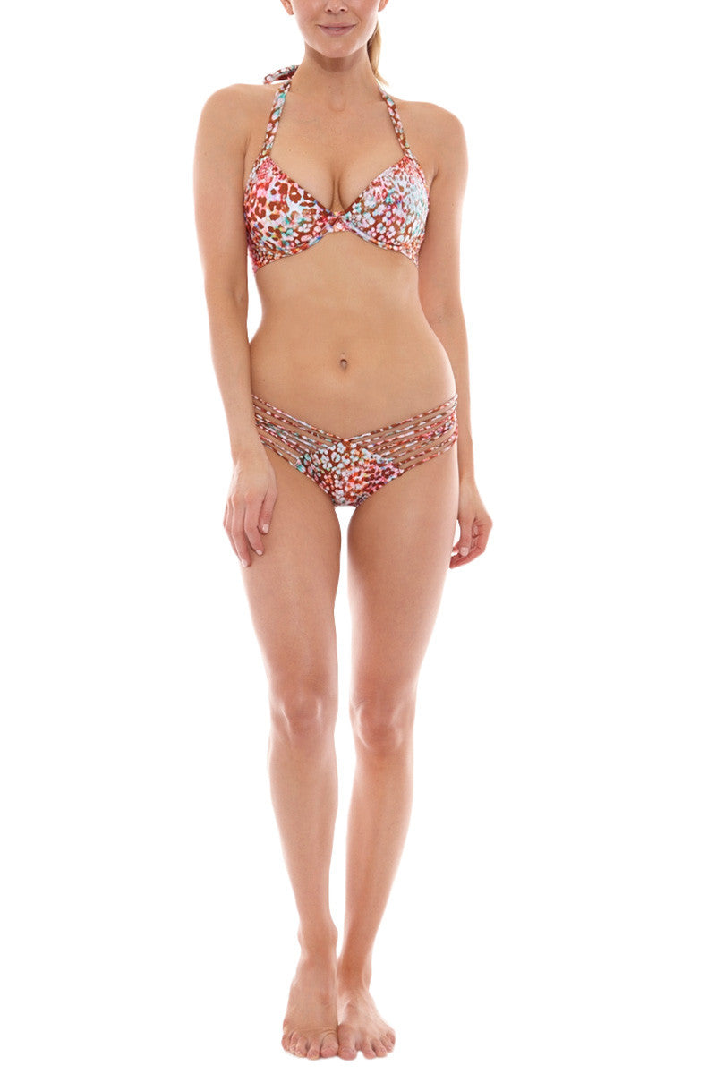LULI FAMA Strappy Ruched Brazilian Bikini Bottom - Untameable Animal Print Bikini Bottom | Untameable Animal Print| Luli Fama Strappy Ruched Brazilian Bikini Bottom - Untameable Animal Print * Cheeky coverage bikini bottoms i  * Ruching at rear subtly accentuates your booty for a touch of cheekiness. * Delicate multi-strap hip detail adds a flirty twist to the simple silhouette. * Hipster style Front View