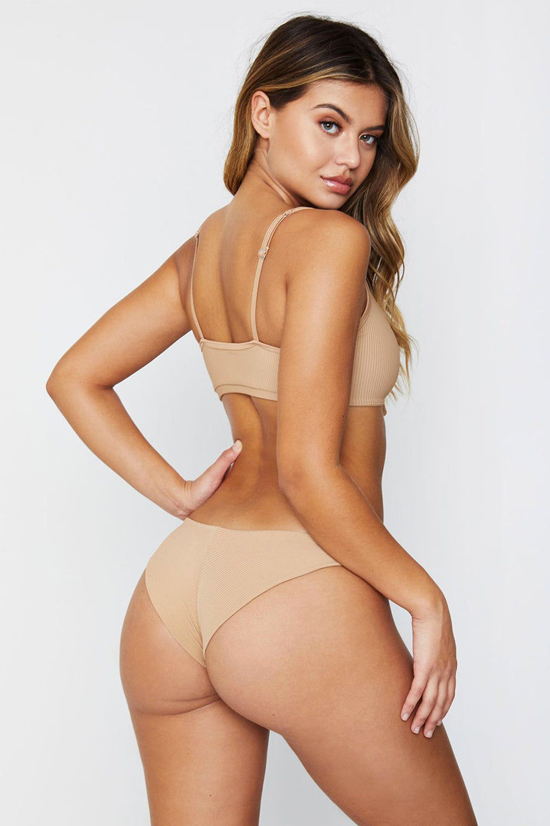 FRANKIES BIKINIS Greer Ribbed Cheeky Bikini Bottom - Nude Bikini Bottom | Nude| Frankies Bikinis Greer Ribbed Cheeky Bikini Bottom - Nude Low-rise hipster style ribbed cheeky coverage Wide side straps  Vertical seam Back View