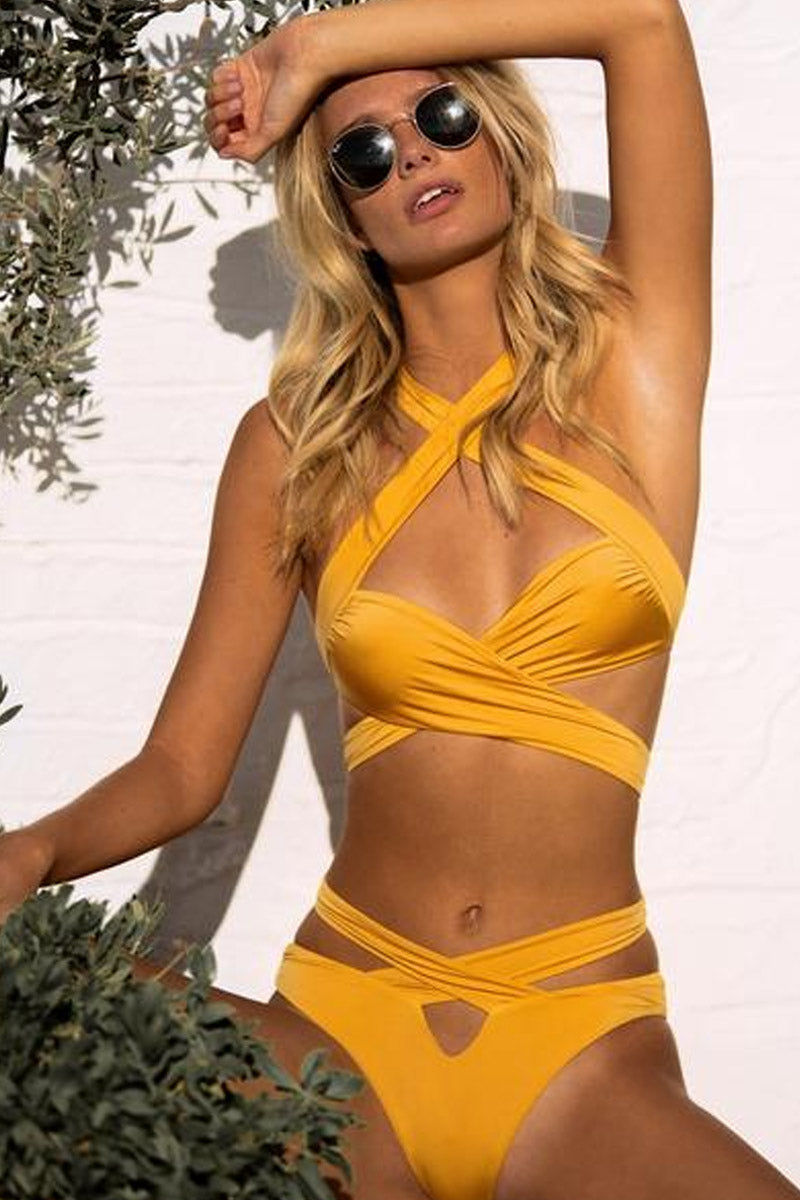 MONICA HANSEN BEACHWEAR Endless Summer Cross Over Bikini Top - Honey Yellow Bikini Top | Honey Yellow| Monica Hansen Beachwear Endless Summer Cross Over Bikini Top - Honey Yellow. Features:  Straps cross in front over the chest and under the chest Straps also cross in back over the shoulders double fabric on the inside instead of lining Italian fabric 85% Nylon 15% Elastane Manufactured in Italy Hand wash cold.  Dry Flat Front View