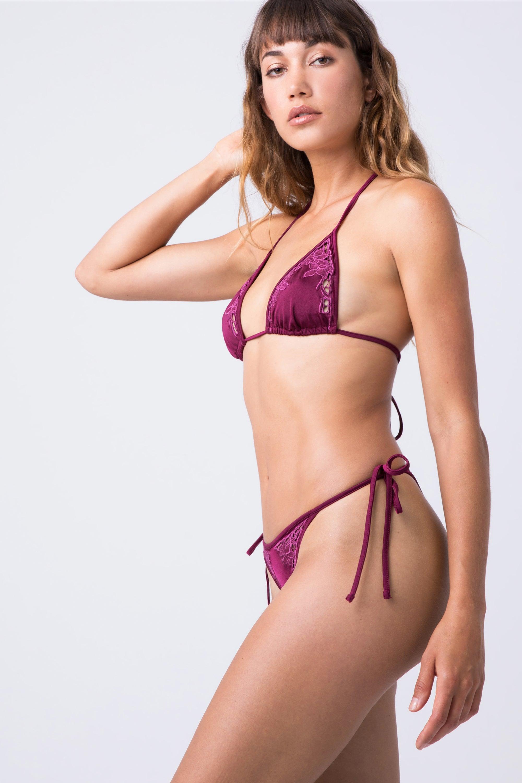 INDAH Lewis Lace Tie Side Bikini Bottom - Bordeaux Bikini Bottom | Bordeaux| Indah Lewis Lace Tie Side Bikini Bottom - Bordeaux Features:  Tie Side Bottom  High Cut Leg  Thong Coverage  Lace Detail Side View