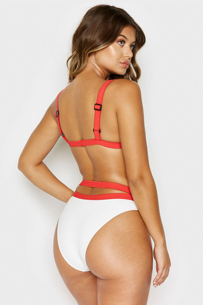 FRANKIES BIKINIS Kiki Cheeky Ribbed Bikini Bottom - White Bikini Bottom | White| Frankies Bikinis Kiki Cheeky Ribbed Bikini Bottom - White. Modest and edgy - the Kiki Bottoms feature an ultra-flattering high waist fit in our buttery-soft rib fabric. Complete with strappy contrasted elastic detailing that highlights your waist and matte black buckle closures.   Fabric  88% nylon 12% spandex Luxe Ribbed Fabric Black Buckle Detail Booty Coverage Back View