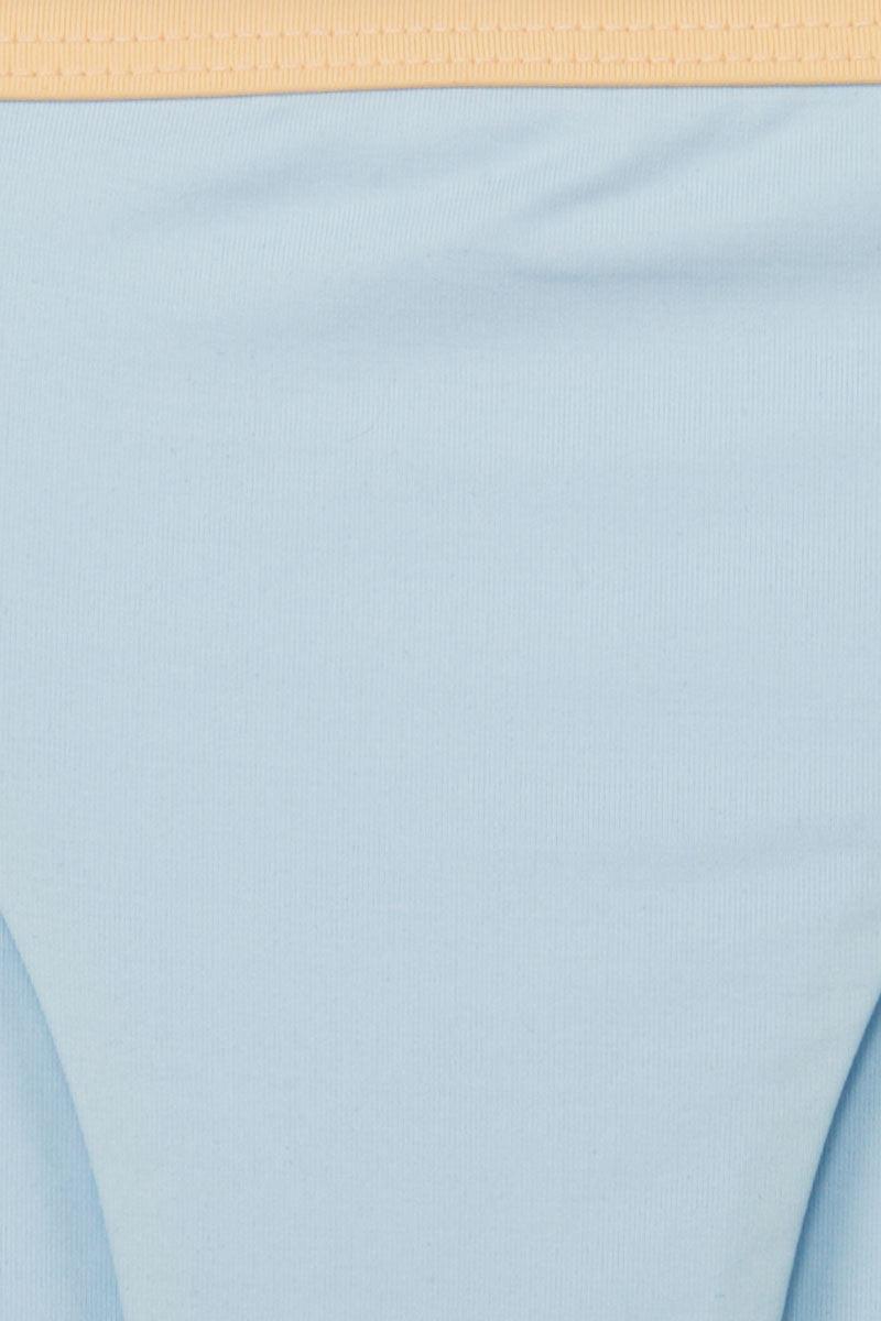 KORE Siren Color Block Side Strap Cheeky Bikini Bottom - Peach Orange/Sky Blue Bikini Bottom | Peach Orange/Sky Blue| KORE Siren Color Block Side Strap Cheeky Bikini Bottom - Peach Orange/Sky Blue Low-rise double side strap cheeky bikini bottom in pastel blue. On-trend color blocking in baby blue and soft peach for a feminine look. Front View