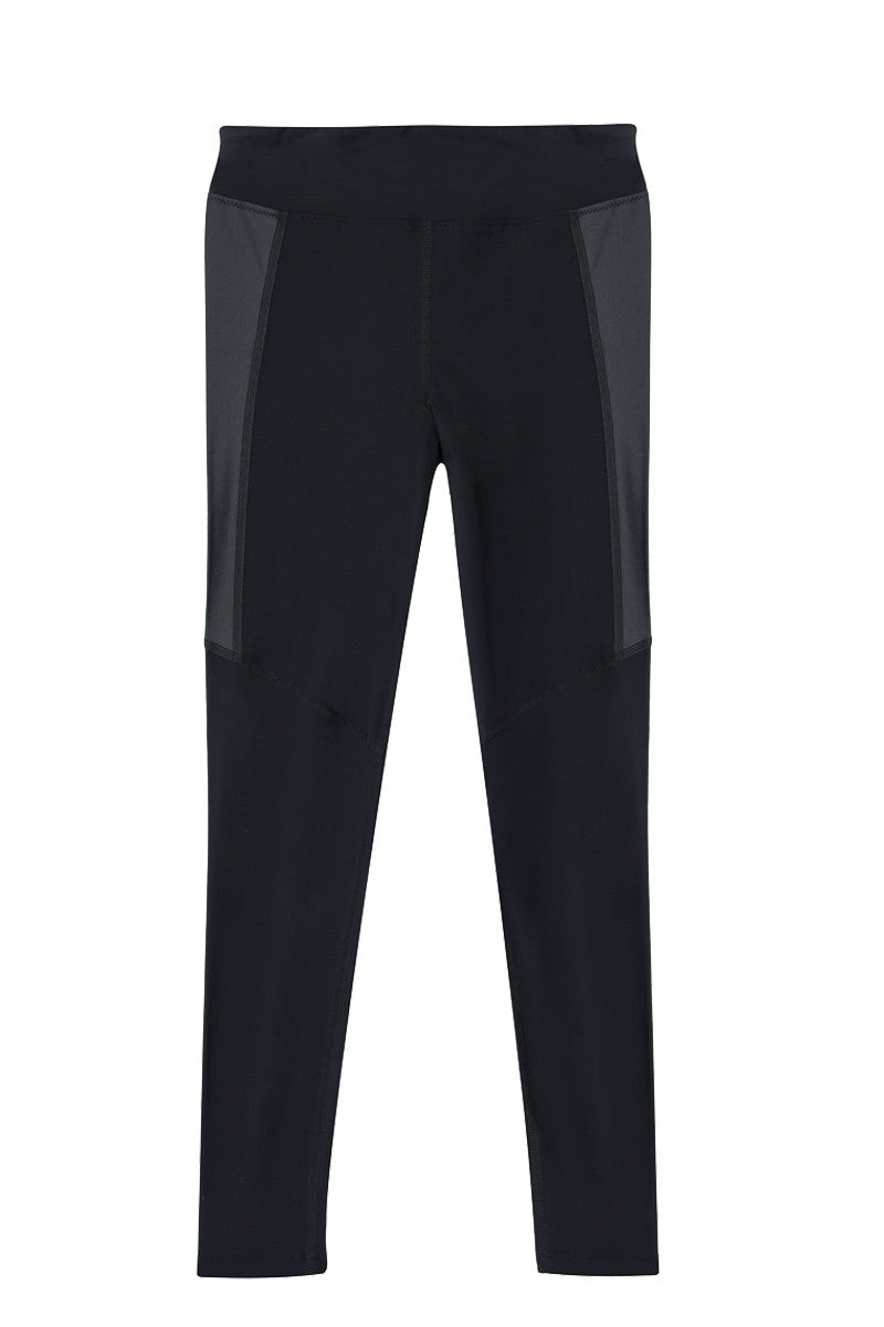 KORE Pipes High Waist Surf Leggings - Onyx Black Leggings | Onyx Black| KORE Pipes High Waist Surf Leggings - Onyx Black High-waisted full length versatile stretch leggings in classic black. The flattering high-rise silhouette stays put while surfing, practicing yoga, or exercising. Crafted from stretch-fit fabric for the most comfortable fit that retains shape over time. Sleek gloss-finish panels at the sides create a leather-like look for ultimate edge. For superior coverage and sun protection, pair these pants with a long sleeved high neck rash guard. Front View