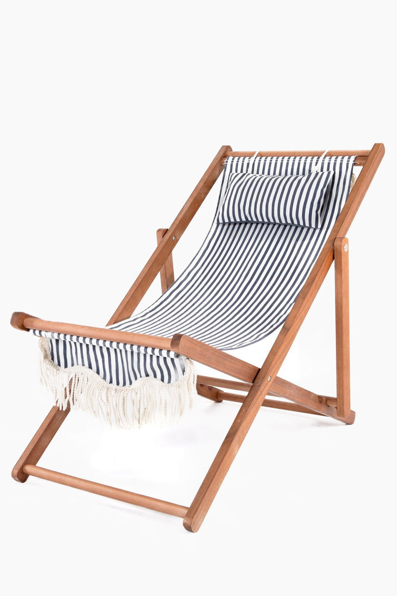 BUSINESS AND PLEASURE CO Premium Sling Chair - Laurens Stripe Navy Home | Laurens Stripe Navy| BUSINESS AND PLEASURE CO Premium Sling Chair - Laurens Stripe Navy. Features:  Renowned Umbrella Canvas (UV, Mould and Water-Resistant). Hardwood frame (also with weather resistant coating).  Natural cotton tasseled fringe. Stainless Steel components Front View