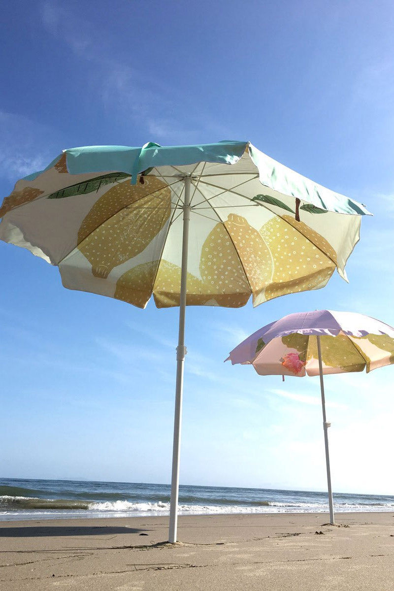 "BUSINESS AND PLEASURE CO Family Beach Umbrella - Lemon Green Pastel Pool Accessories |  Lemon Green Pastel | BUSINESS AND PLEASURE CO Family Beach Umbrella - Lemon Green Pastel. Features:  Large 6"" Span. Printed poly/cotton canvas with UV & Water Resistant treatment. World forestries certified, reclaimed timber wood Pole with Chestnut finish. Natural cotton Fringe & Internal trim. Canvas Carry Bag in same print design. Natural cardboard gift box. Front View"