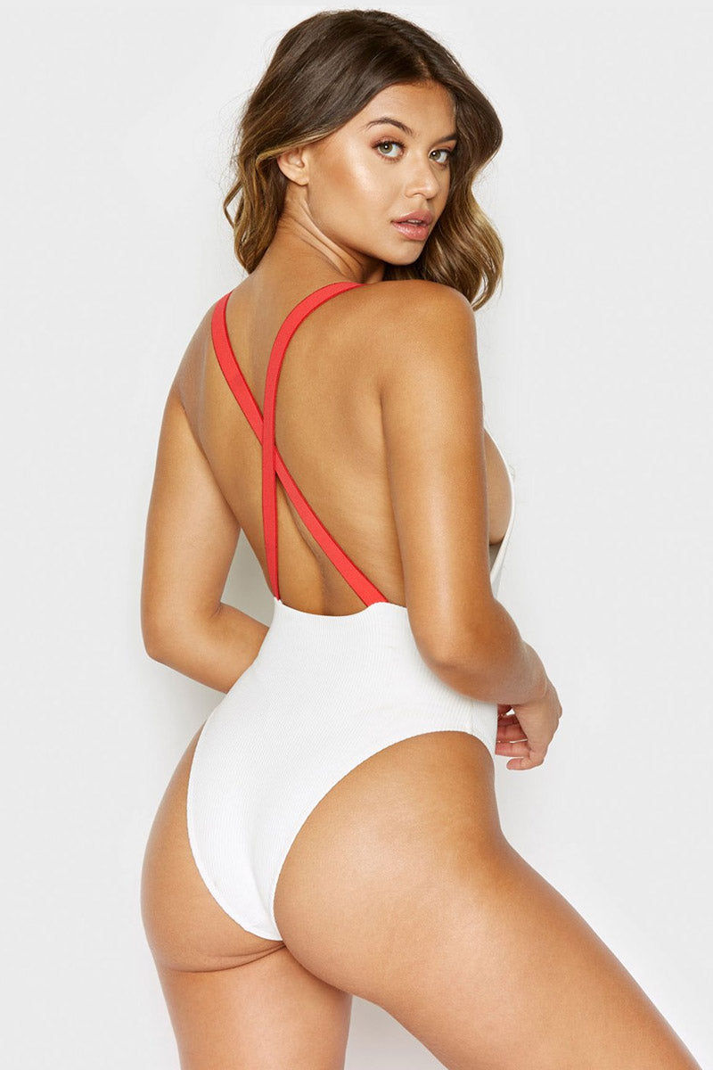 FRANKIES BIKINIS Leo Cheeky Ribbed One Piece Swimsuit - White One Piece | White| Leo Cheeky Ribbed One Piece Swimsuit - White. low back with comfortable and supportive criss cross elastic straps and cheeky fit. Double lined in our buttery-soft rib fabric with contract elastic detailing and matte black buckle closures.  Fabric  88% nylon 12% spandex Luxe Ribbed Fabric Black Buckle Detail Cheeky Coverage Back View