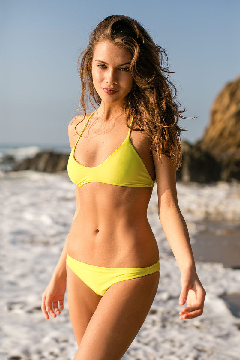 MIKOH Miyako Minimal Bikini Bottom - Plumeria Yellow Bikini Bottom | Plumeria Yellow| Mikoh Miyako Minimal Bikini Bottom - Plumeria Yellow Minimal coverage Seamless Fully lined 80% Nylon, 20% Spandex Front View