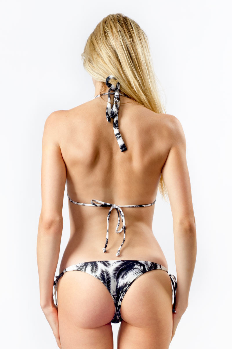 MIKOH Venice Tie Side Brazilian Bikini Bottom - Polynesian Palm Print Bikini Bottom | Polynesian Palm Print|Mikoh  Venice Tie Side Brazilian Bikini Bottom - Polynesian Palm Print. Features: Low Rise Fit. Brazilian coverage, ties at sides for adjustable fit. Double lined. View: On model, full back view.