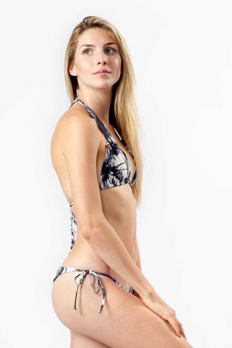 MIKOH Venice Tie Side Brazilian Bikini Bottom - Polynesian Palm Print Bikini Bottom | Polynesian Palm Print|Mikoh  Venice Tie Side Brazilian Bikini Bottom - Polynesian Palm Print. Features: Low Rise Fit. Brazilian coverage, ties at sides for adjustable fit. Double lined. View: On model, full side view.