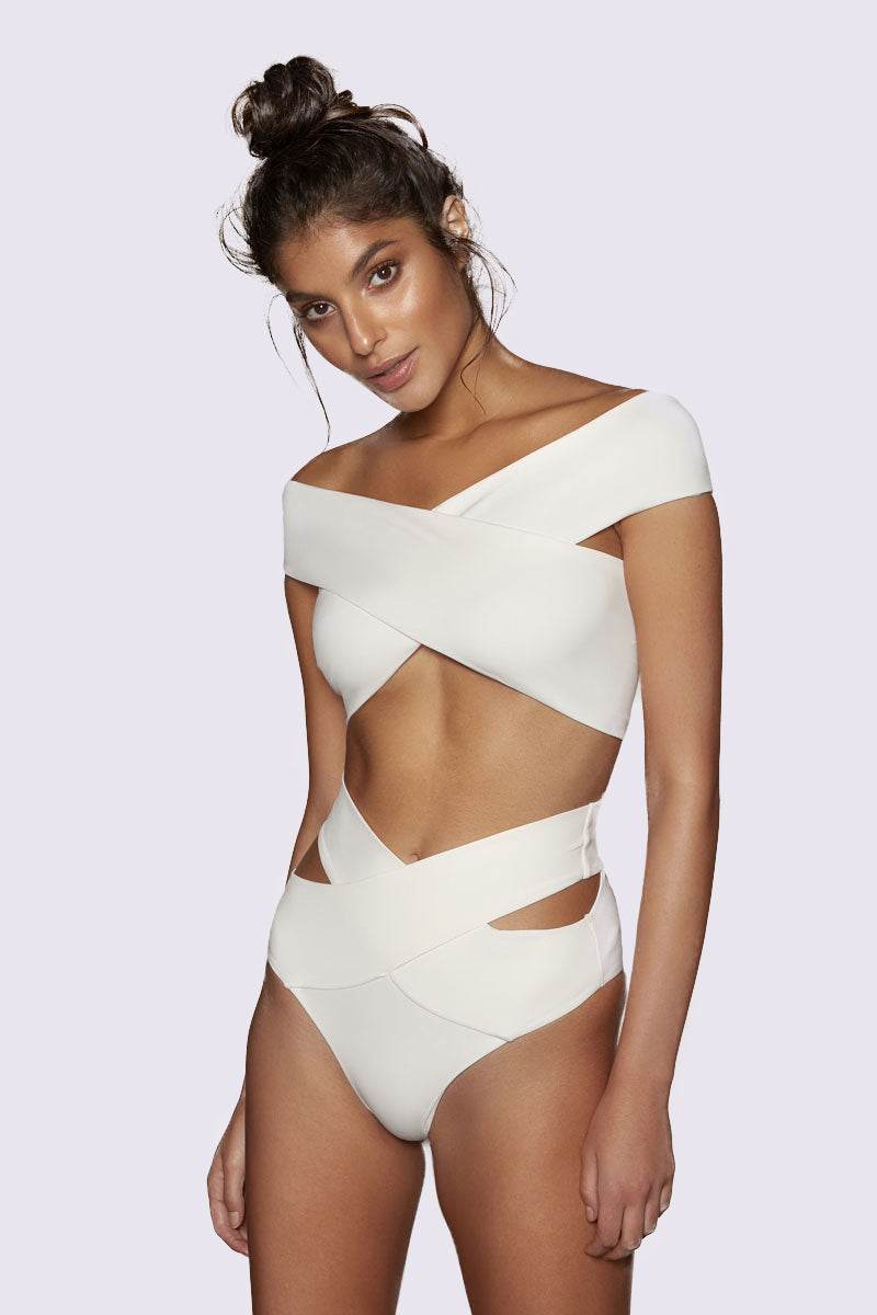 KOPPER & ZINK Mila Off Shoulder Bikini Top - Cream Bikini Top |  Cream| Kopper & Zink Mila Off Shoulder Bikini Top - Cream. Features:  Lightweight neoprene bikini top  Off the shoulder style  Supportive fabric  Gripper tape inside top edge for support  Custom rose gold hardware Front View