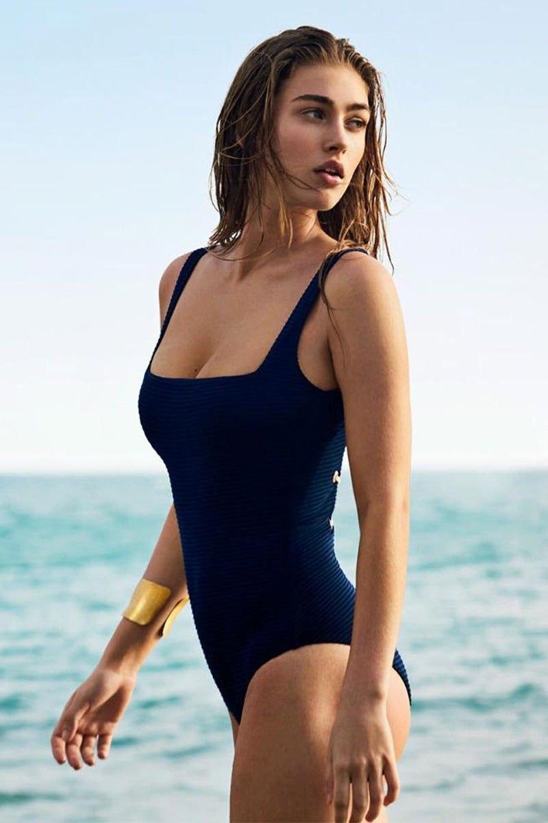 HEIDI KLEIN Lace Back One Piece Swimsuit - Navy One Piece | Navy| Heidi Klein Lace Back One Piece Swimsuit - Navy. Features:  Square cut front neckline and scooped back with decorative and adjustable lacing. Bottom cut for mid coverage. Wide, adjustable shoulder straps for a secure fit. Soft side seam boning to enhance bust support.  Front View