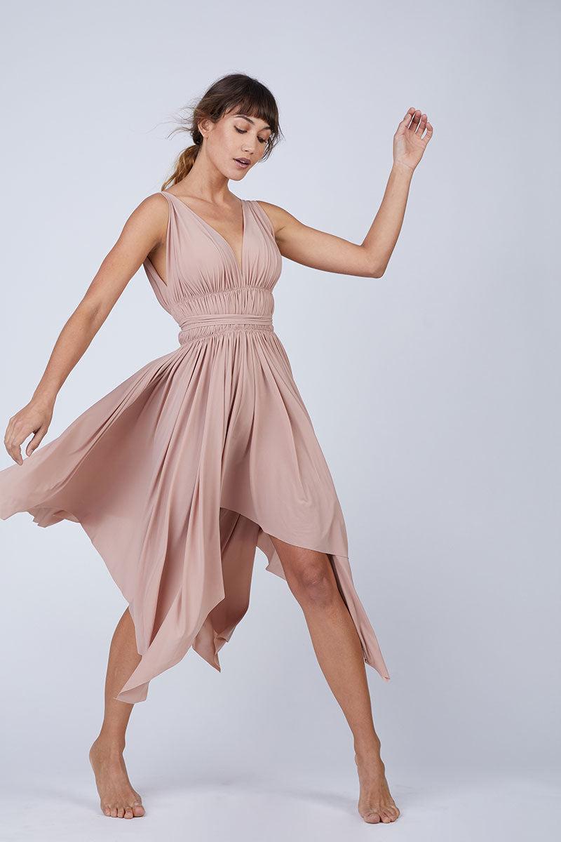 NORMA KAMALI Goddess Dress - Rose Dress | Rose | Norma Kamali Goddess Dress - Rose Front View Deep V Neckline Lightly Draped Bust  String Tie at Waist  Draped Asymmetric Skirt  Handkerchief Hem  Unlined Polyester