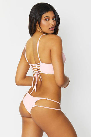 FRANKIES BIKINIS Paige Strappy Cheeky Bikini Bottom - Rose Water Bikini Bottom | Rose Water| Frankies Bikinis Paige Bottom Light pink bikini bottom with cheeky coverage. Two thin strap details on each side with gold ring accents.