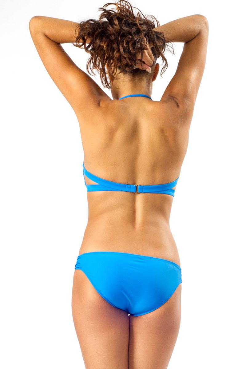 RAISINS Summer Cut Out Twist Bandeau Bikini Top - Electric Waters Blue Bikini Top | Electric Waters Blue| Raisins Summer Cut Out Twist Bandeau Bikini Top - Electric Waters Blue Cut out front detail. Removable halter strap. Back View