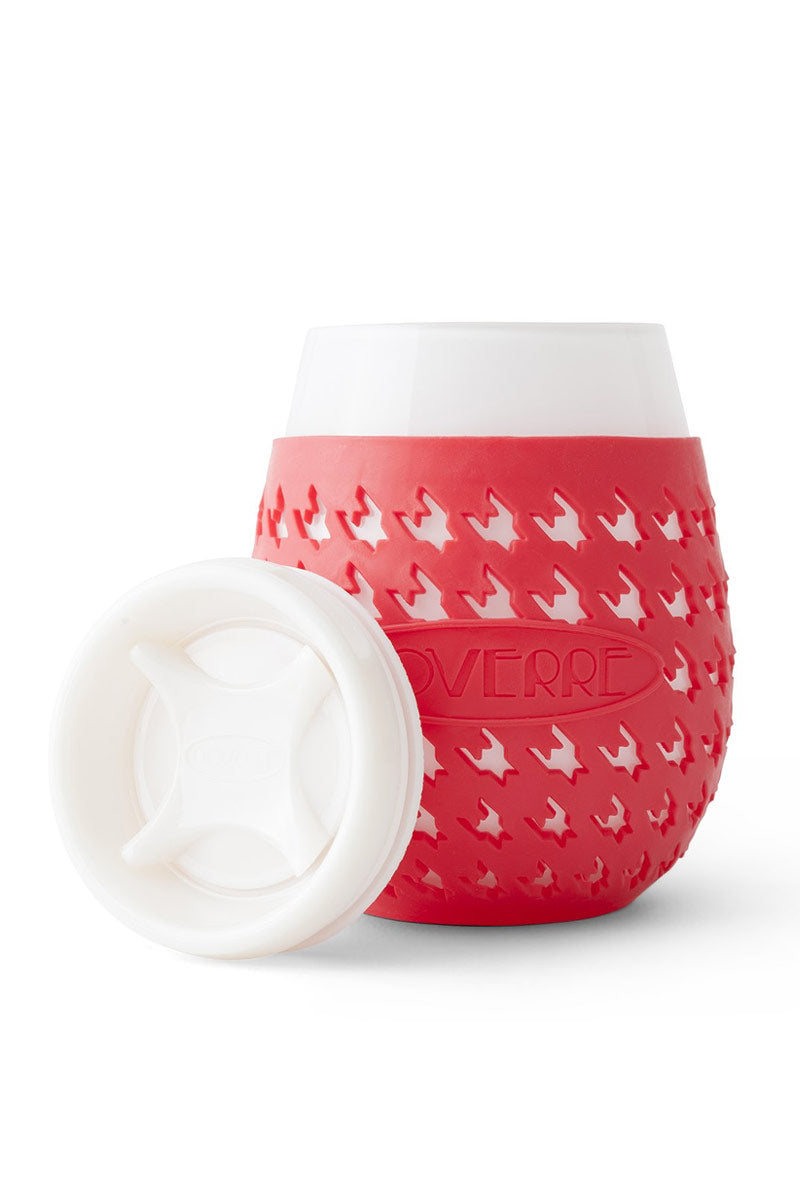 """GOVERRE Wine Glass Sippy Cup - Red Accessories   Red  Goverre Wine Glass Sippy Cup - Red  Stemless wine glass with a silicone sleeve and a drink-through lid. Holds 17oz of your favorite beverage  Durable—thicker(.25"""") than a typical wine glass  Preserves taste and integrity of your wine Silicone sleeve - Houndstooth-patterned silicone sleeve prevents heat transfer and provides a no-slip grip Phthalate and lead free Dishwasher safe Front View"""