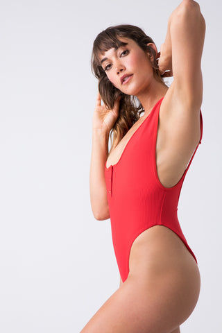 FRANKIES BIKINIS Adele Ribbed Scoop High Cut One Piece Swimsuit - Red Hot One Piece | Red Hot| Frankies Bikinis Adele Ribbed Scoop High Cut One Piece Swimsuit -  Red Hot henley inspired high cut ribbed one piece swimsuit with a low back scoop and cheeky coverage. Side View