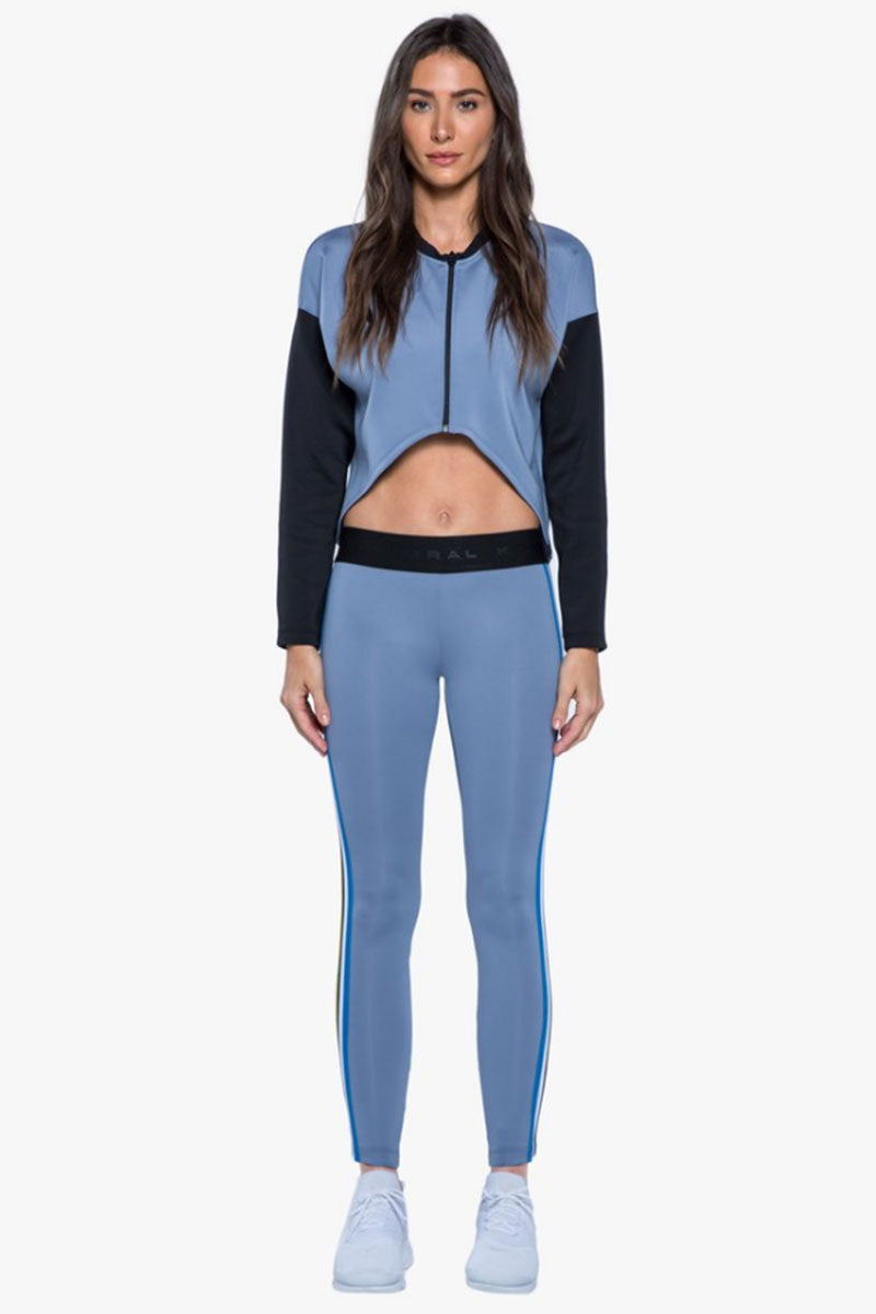 KORAL Rhys Leggings - Nova Blue Leggings |  Nova Blue| Koral Rhys Leggings - Nova Blue. Features:  Mid rise legging Side strap details Meant for athleisure Machine wash cold, inside out with like colors; No bleach; Tumble dry low MADE IN USA Front View