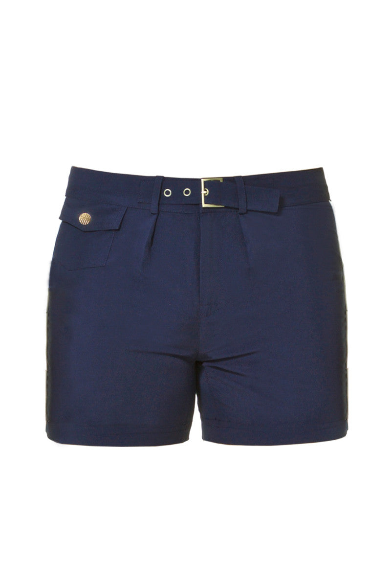 J.LIN Sailor Mid Length Swim Trunks - Classic Navy Mens Swim | Classic Navy| J. Lin Sailor Swim Sailor Mid Length Swim Trunks - Classic Navy. Flat Lay Front View. Mid-length  Buckle closure at center front  Forward seam with white pipping Snap front pocket, open back pocket White stretch lining   100% Polyester