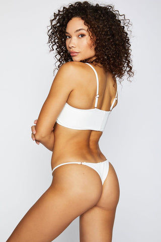 FRANKIES BIKINIS Sara Ribbed Thong Bikini Bottom - White Bikini Bottom | White| Frankies Bikinis Sara Ribbed Thong Bikini Bottom - White Low rise Thin side straps  Thong coverage  Back View