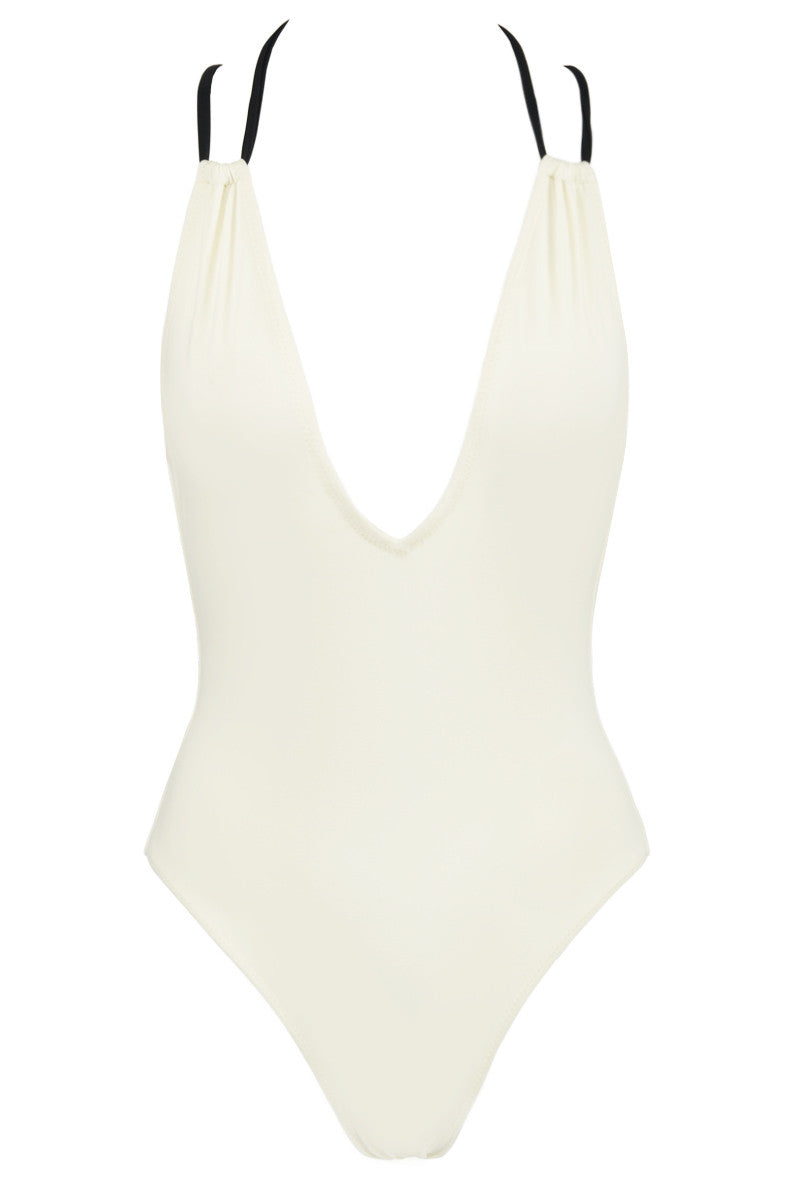 SOLID & STRIPED The Alexandra One Piece Swimsuit - Cream One Piece | Cream|The Alexandra One Piece Swimsuit - Plunging cream colored one piece swimsuit with contrast black criss-cross straps. Supportive black double shoulder straps cross into intricate lacing back. Single black halter strap secures swimsuit behind neck while longer back tie criss-crosses over deep open back, loops through sides, and ties in center of back with a feminine bow.