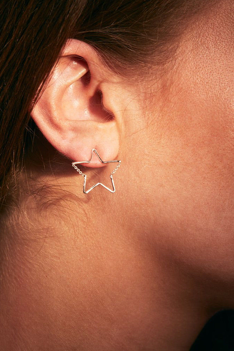 EACH JEWELS Star Chain Stud Earrings - Silver Jewelry   Silver  Each Jewels Star Chain Stud Earrings - Silver Star stud earrings Chain creates 2 angles of the star  Chain moves when you do Silicone backings included Made in NYC Side View