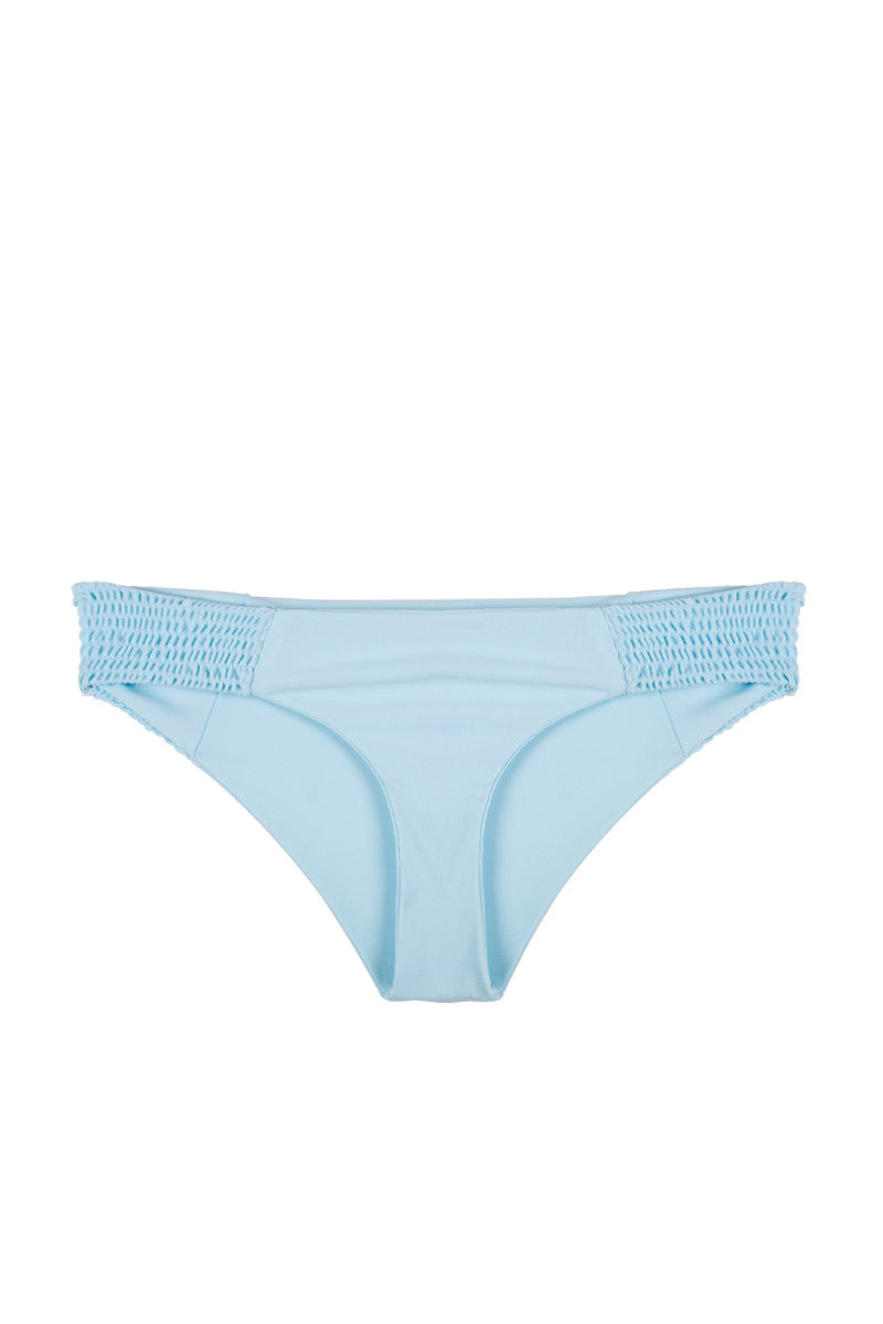 TORI PRAVER Daisy Smocked Moderate Bikini Bottom - Mist Blue Bikini Bottom | Mist Blue|Tori Praver Daisy Smocked Moderate Bikini Bottom - Mist Blue. Features: Low-rise bikini bottom in flattering pale blue fabric with shirring detail. Smocked textured panels on sides add dimension to the bikini bottom. Hipster front cut and cheeky back show off your curves while still providing moderate coverage.Front View