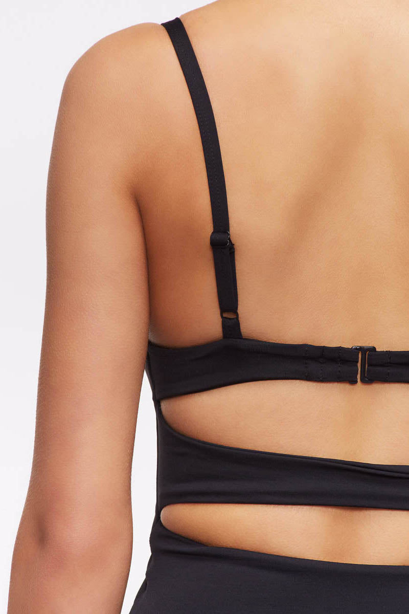 TAVIK Penelope One Piece Swimsuit - Black One Piece | Black|Penelope One Piece - Features:  Moderate Coverage Cut out at middle Adjustable straps Clasp closure back